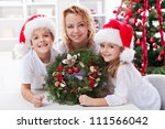 Our first home made advent wreath - family together at christmas time - stock photo