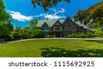 luxury house in the suburbs of... | Shutterstock . vector #1115692925