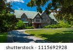 luxury house in the suburbs of... | Shutterstock . vector #1115692928