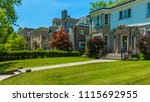 luxury house in the suburbs of... | Shutterstock . vector #1115692955