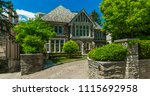 luxury house in the suburbs of... | Shutterstock . vector #1115692958