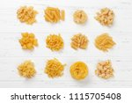 various pasta on white wooden... | Shutterstock . vector #1115705408