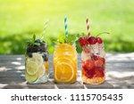 fresh lemonade jar with summer... | Shutterstock . vector #1115705435