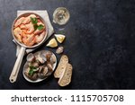 fresh seafood and white wine on ... | Shutterstock . vector #1115705708