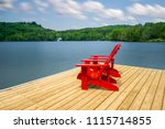 two muskoka chairs sitting on a ... | Shutterstock . vector #1115714855