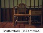 rattan chair on floor  interior ... | Shutterstock . vector #1115744066