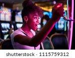 woman having fun playing slot... | Shutterstock . vector #1115759312