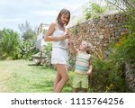 fashionable nordic mother... | Shutterstock . vector #1115764256