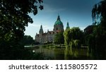 Stock photo new city hall of hannover reflecting in water lower saxony germany 1115805572