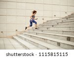 fit young woman running up the... | Shutterstock . vector #1115815115
