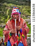 the old man quechua dressed in... | Shutterstock . vector #1115866658