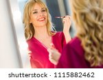 shot of pretty young woman... | Shutterstock . vector #1115882462