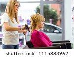 shot of hairdresser drying... | Shutterstock . vector #1115883962