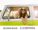 young woman enjoying a roadtrip | Shutterstock . vector #1115895056