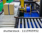automatic box strapping packing ... | Shutterstock . vector #1115905952