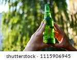 a light cold beer like a cup in ... | Shutterstock . vector #1115906945