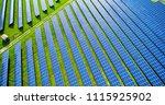 solar panels in aerial view | Shutterstock . vector #1115925902