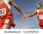 male athletes passing baton in... | Shutterstock . vector #111592922