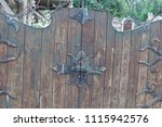 old wooden gate with padlocks.... | Shutterstock . vector #1115942576