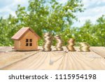 a wooden house and a ladder of... | Shutterstock . vector #1115954198