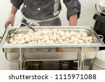 the meatballs and the hands of... | Shutterstock . vector #1115971088