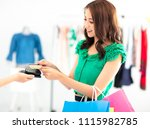 young woman shopping in clothes ... | Shutterstock . vector #1115982785