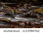 Long exposure of fast moving water in Dartmoor National Park - stock photo