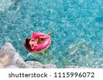 pretty woman lying on floating... | Shutterstock . vector #1115996072