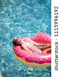 pretty woman lying on floating... | Shutterstock . vector #1115996192