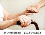 senior woman holding quad cane... | Shutterstock . vector #1115996885
