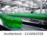 plastic  bottles on factory line | Shutterstock . vector #1116062528