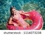 pretty woman lying on floating... | Shutterstock . vector #1116073238