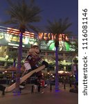 Small photo of Glendale, AZ, USA February 1, 2018 Fans of the Arizona Coyotes hockey team stop to admire a large blow up of Howler, the team's mascot, outside the Gila River Arena in Glendale, Arizona