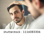 latino person with beard... | Shutterstock . vector #1116083306