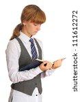 Schoolgirl reading a textbook - stock photo