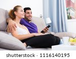 cheerful young couple with tv... | Shutterstock . vector #1116140195