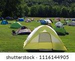 multiple tents in a green field ... | Shutterstock . vector #1116144905