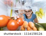 young smiling woman preparing...   Shutterstock . vector #1116158126