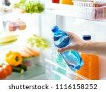 woman taking a bottle of fresh... | Shutterstock . vector #1116158252