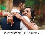 hindu newlyweds hug each other... | Shutterstock . vector #1116184472