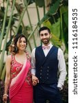 indian bride and groom hold... | Shutterstock . vector #1116184535