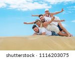 group of friends in the sand ... | Shutterstock . vector #1116203075