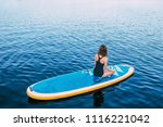 young woman meditating on...   Shutterstock . vector #1116221042