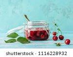 cherry jam in jar on wooden... | Shutterstock . vector #1116228932