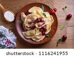dumplings  filled with cherries ... | Shutterstock . vector #1116241955