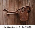 Old Wooden Door With Chain Ke...