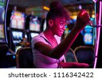 Happy woman gambling at casino...