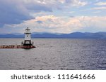 Small And Quaint Lighthouse On...