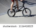 teenager riding a bike on a... | Shutterstock . vector #1116418325
