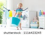 child in laundry room with...   Shutterstock . vector #1116423245